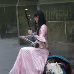 Perfectly pink Chinese cello player